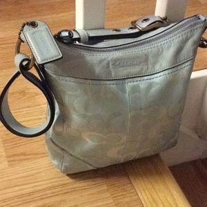 Blue cloth coach purse